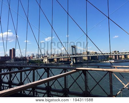 The city and Manhattan bridge over the river from Brooklyn bridge view, New York