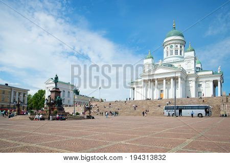 HELSINKI, FINLAND - JUNE 11, 2017: Monument to the Russian Emperor Alexander II and the Cathedral of St. Nicholas on the Senate Square