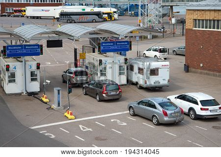 HELSINKI, FINLAND - JUNE 11, 2017: Cars in line for loading by sea ferry of the company