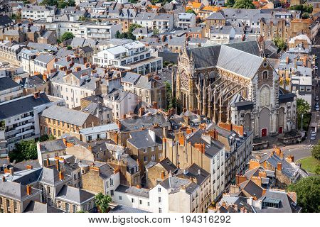 Aerial cityscape view with beautiful buildings and saint Nicolas cathedral in Nantes city during the sunny weather in France