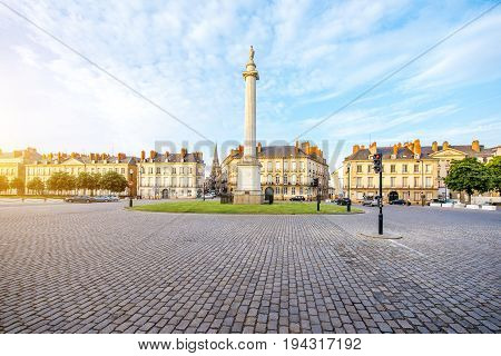 Street view on the Marechal-Foch sqaure with Louis column during the sunset in Nantes city in France