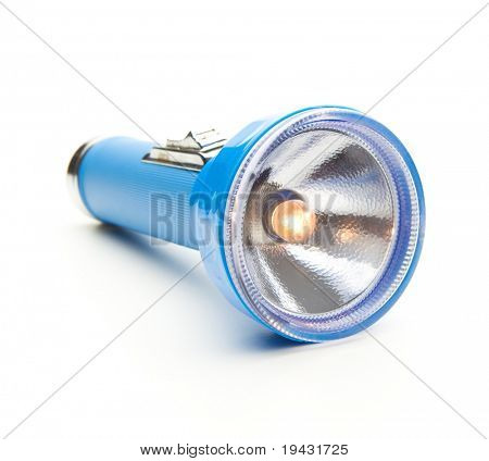 Blue torch type flashlight with lighted bulb isolated on white with natural shadow