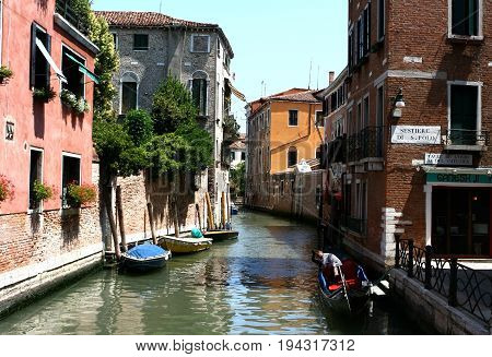 Venice, Italy - June 29, 2012 - Street and canal of Venice in Venice, Italy