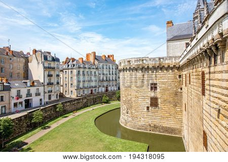 City scape view with castle wall and beautiful buildings in Nantes city during the sunny weather in France