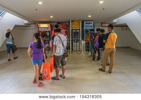 Kota Kinabalu,Sabah,Malaysia-June 17,2017:People using the ATM (Automatic Teller Machine) to withdraw & transfer money in Suria KK Shopping Complex at Kota Kinabalu,Sabah,Malaysia.