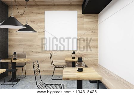 Wooden and white wall cafe interior with old oil lamps on square wooden tables and a large vertical poster hanging on a gray wall. Close up. 3d rendering mock up