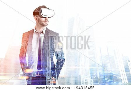 Front view of a bearded man wearing a suit and VR glasses and standing against a modern foggy cityscape. Toned image double exposure mock up