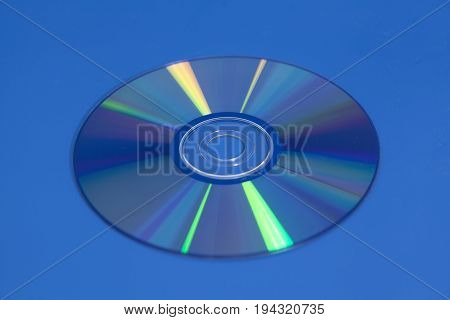 Compact Dvd Cd disk on blue background