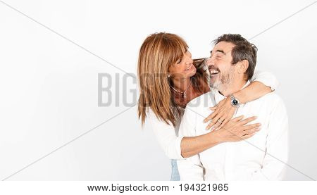 Senior couple posing happily in a photo studio