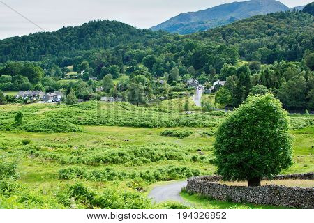 Lake District National Park, England, view of the road, town, mountains on the background, selective focus
