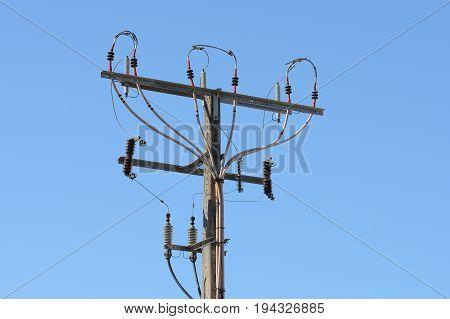 pole of power line against the blue sky