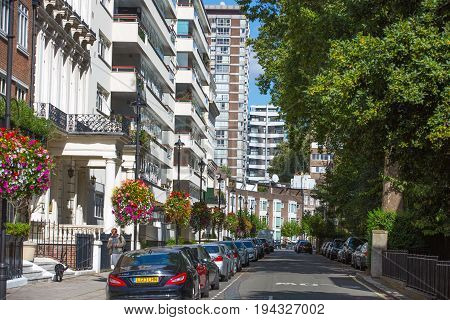 London, UK - September 8, 2016: Residential aria of Bayswater with row of periodic buildings. Luxury property in the centre of London.