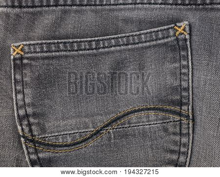 Fabric Texture Close Up of Black Denim Jean Texture with Back Pocket Detail.