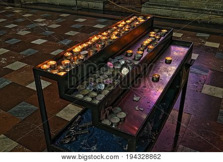Czech Republic, Prague. Rows of burning candles in St. Vitus Cathedral