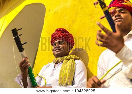 Young Indians playing traditional rajasthani music on the street of Jaipur, Rajasthan, India