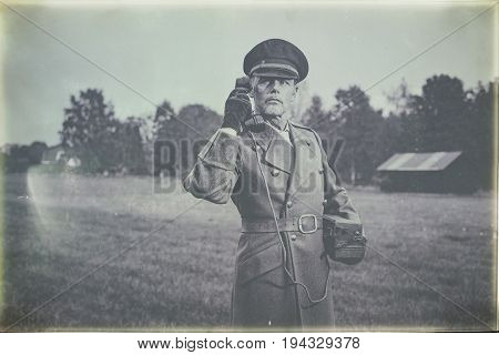 Antique Black And White Photo Of 1940S Military Officer Calling With Field Phone While Standing On F