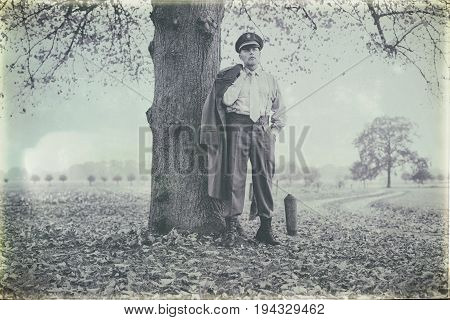 Antique Black And White Photo Of 1940S Military Officer Standing Under Tree.