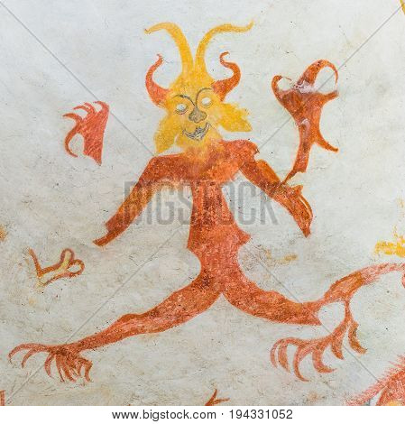 Devil with big claws a medieval mural in Vinderslev church Denmark June 22 2017