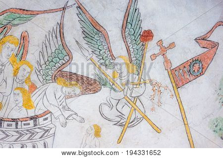 Angel with torture instruments medieval gothic fresco in Vinderslev church Denmark June 22 2017