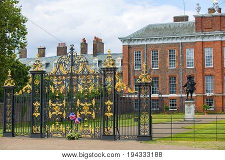 London, UK - September 8, 2016:   Kensington palace in the Hyde park and King William III statue