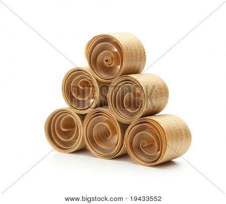 Beautiful spiral wood shavings , created by a hand plane. stacked up to form a triangle.