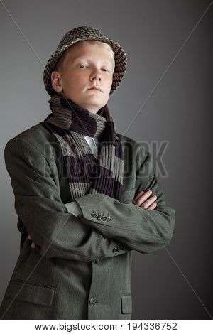 Cute Blond Boy In Hat And Scarf