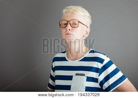 Blond Teen In Striped Shirt With Tough Expression