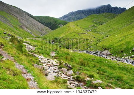 Path to Scafell Pike, view of the mountains, stream, Lake District National Park, England, selective focus