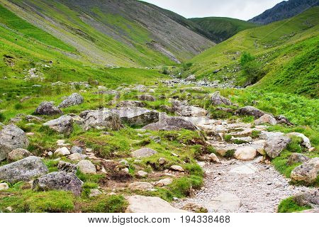 Lake District National Park, path to Scafell Pike, view of the mountains, stream, England, selective focus