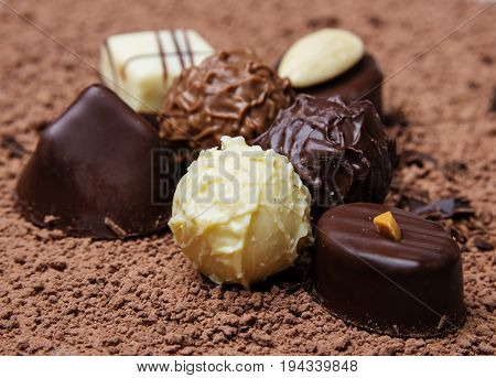 a chocolate background with pralines close up