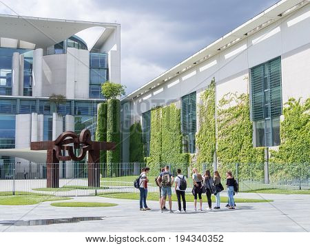 BERLIN GERMANY - APRIL 6 2017: Student Group In Front of Chancellor's Office Building With A Blue Cloudy Sky In Berlin