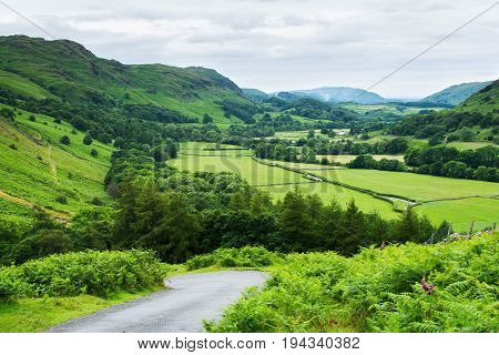 Roadside views in Lake District National Park, England, mountains on the background, selective focus