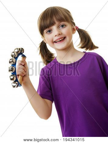 little girl playing music with jingle bell