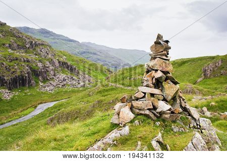 Views in Lake District National Park, England, built stone formation, mountains on the background, selective focus