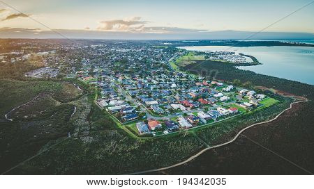 Aerial panoramic view of Hastings suburb and Westernport Marina at dusk. Melbourne Australia