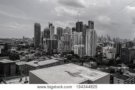 Aerial drone view of Bangkok during cloudy day - black and white photo