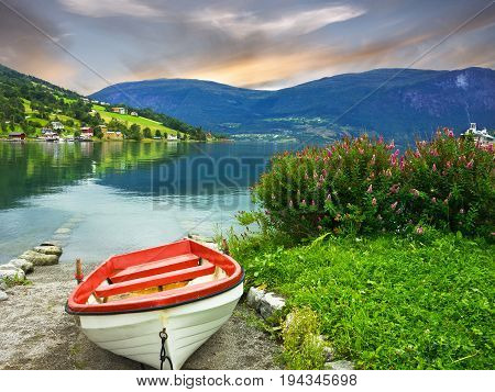 Boat on the beach of Norwegian village Olden.