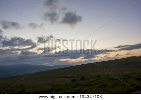 The evening sky, decline, picturesque landscape, clouds over the valley