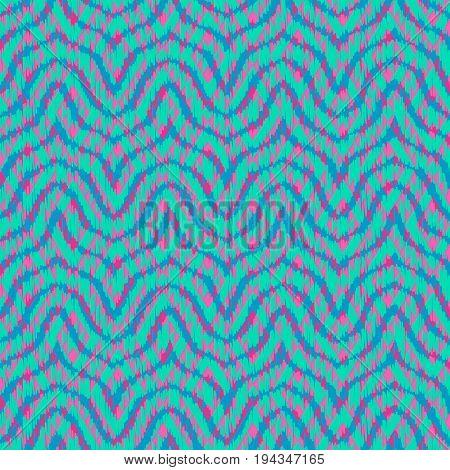 Seamless chevron geometric pattern, based on ikat fabric style.