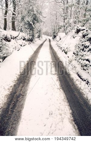 Snow covered dirt road in countryside. Kent England.
