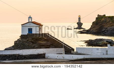 Church St. Thalassini and lighthouse, landmarks of Andros town.