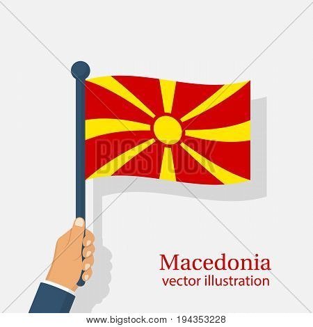 Macedonia flag holding in hand. Macedonia Independence Day 8th september. Vector illustration flat design. Isolated on white background.