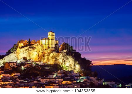 Beautiful sunset in Montefrio and on top of the the rocky outcrop is the Iglesia de la Villa. Granada Spain