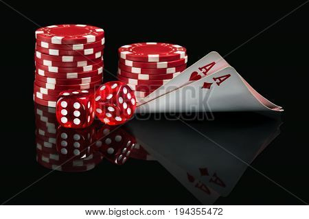 good combination of aces and dice in poker on a black background
