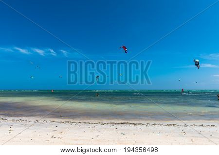 BORACAY, WESTERN VISAYAS, PHILIPPINES - JANUARY 11, 2015: Horizontal perspective of Bulabog Beach with people doing kiteboarding and windsurfing with blue sky in Boracay.