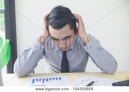 Young Businessman At Computer Covering His Face With His Hands Depressed And Sad Suffering Stress  F