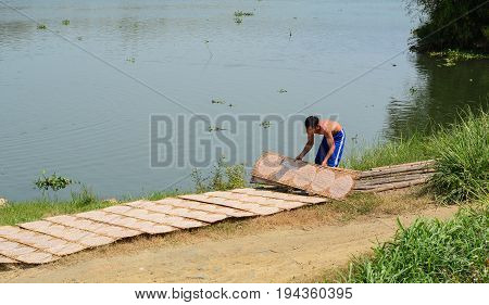 Drying Rice Paper Wrappers On Riverbank