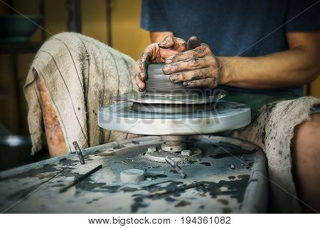 Hands Of Craftsman Artist Making Craft, Pottery, Sculptor From Fresh Wet Clay On Pottery Wheel, Mode