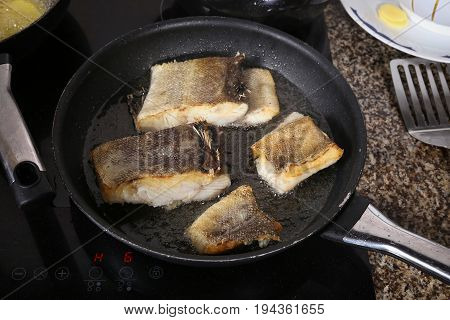 Cook fish in the pan, Top View.