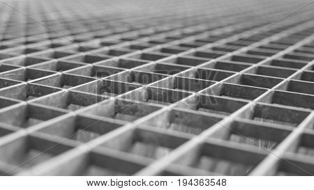 Metal lattice with small cells grid. Stock photo background with shallow DOF and selective focus point.